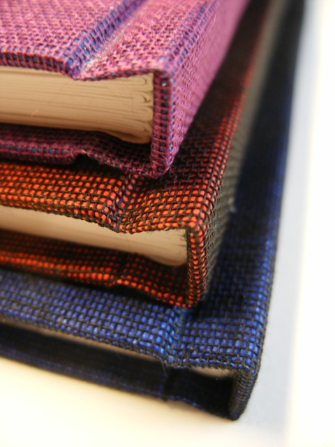 Numbered issue bookcloth covered spines