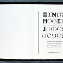Lettered issue within its box, open to the titlepage.